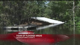 Touring flooded areas near the Black River