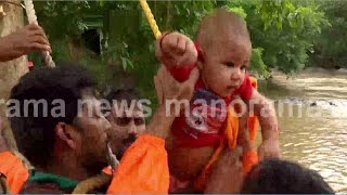 കുത്തിയൊലിച്ച് ഭവാനിപ്പുഴ; കുഞ്ഞിനെ നെഞ്ചിലടക്കി അച്ഛൻ; സാഹസികരക്ഷ: വിഡിയോ   Attappadi Child rescue