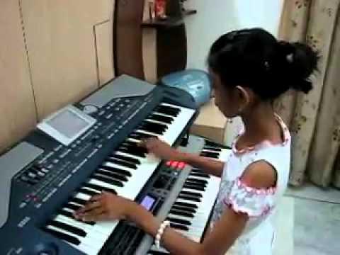 Cute little girl on piano
