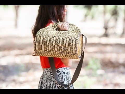 A log shaped purse woven with paper osier