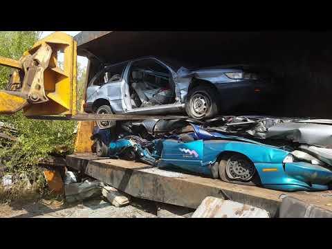 Car crusher crushing cars 36