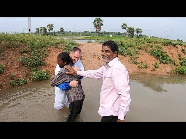 Village canal baptisms in India