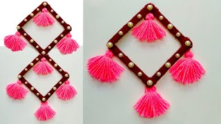 DIY NEW WALL HANGING TORAN IDEA/BEST OUT OF WASTE/ICE CREAM STICKS AND WOOL/NEW DESIGN