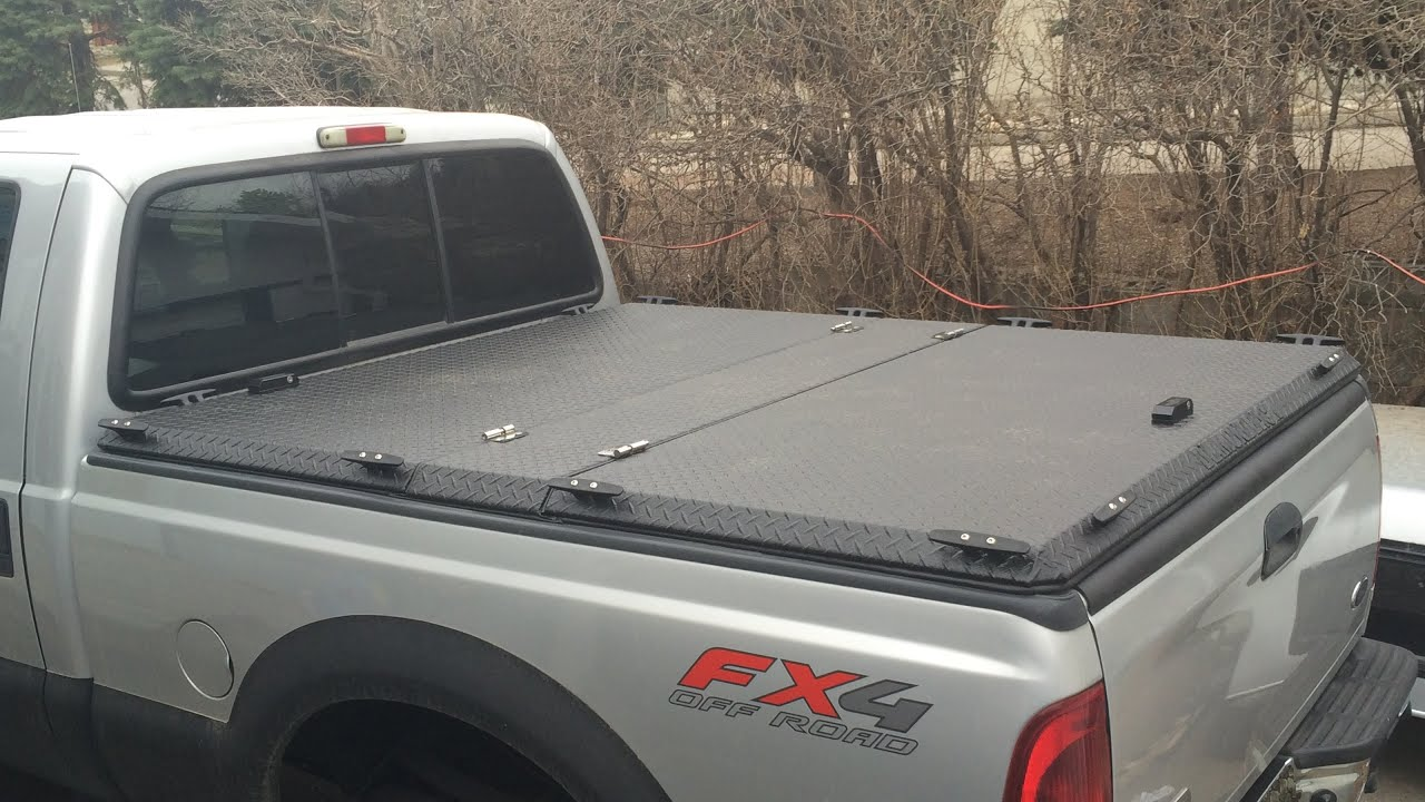 Diamondback truck covers hd cover install youtube for How to cover a bed