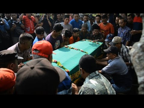 Fainting And Tears At Funeral Of Indonesia Jet Crash Passenger