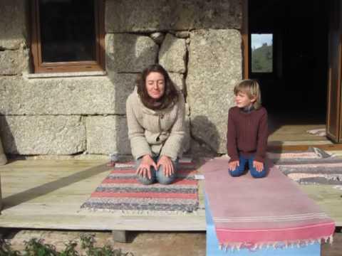 Me and my son practising Simhasana, Lion pose.