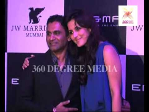 Sexy Tulip Joshi poses with Vinod Nair at the re-launch of 'Enigma'