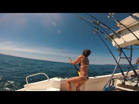 Girl catches giant roosterfish, Bahia Rica, Costa Rica