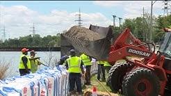 Crews are building flood walls along River Des Peres