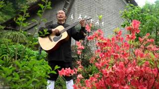 A Taoist Master Sings with his Darling Guitar