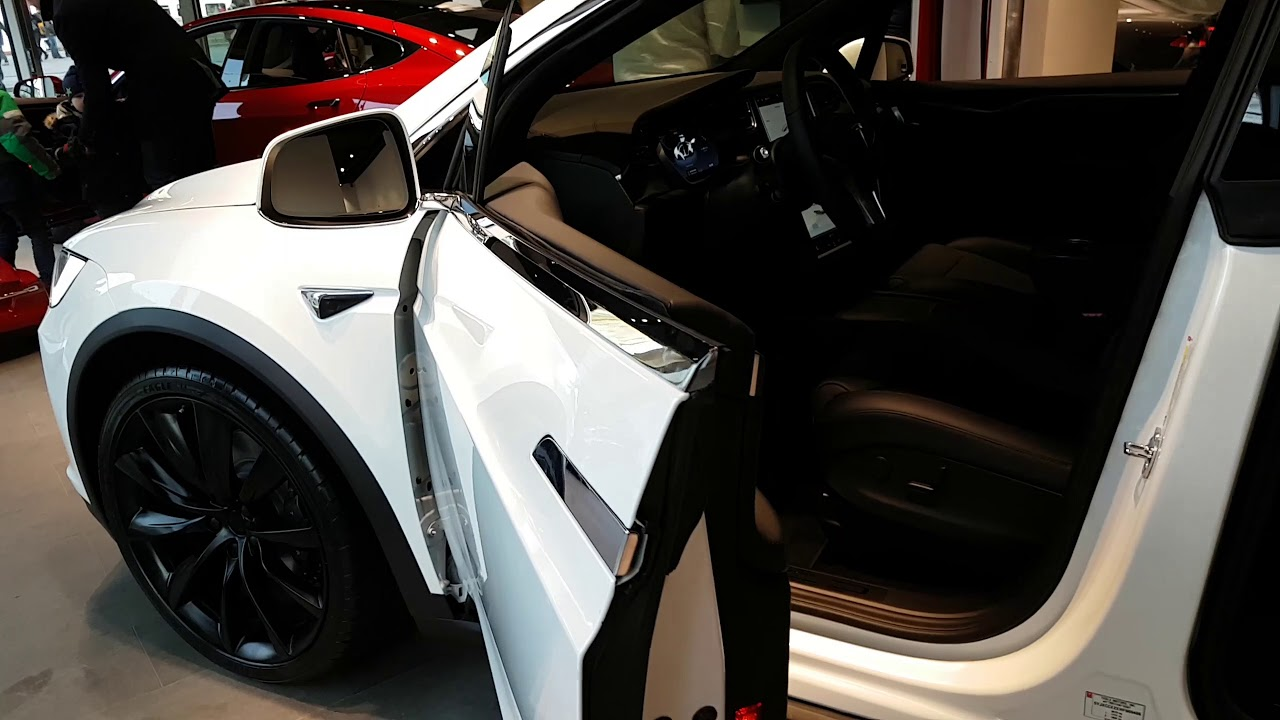 Opening and closing a Tesla Model X front door - YouTube