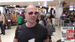 Max George and his fiance Michelle Keegan talk about his shaved head look while departing at LAX Air