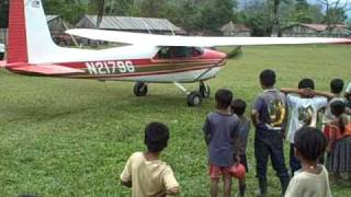 Bush pilot in Guatemala.  Cessna 182 in the jungle.