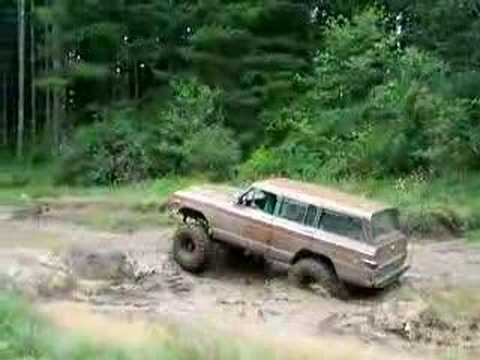 75 jeep wagoneer on 37's playing in mud hole - YouTube