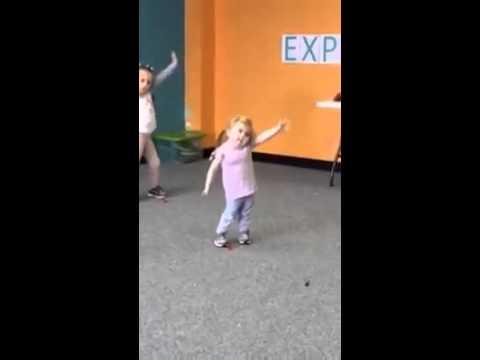Cute young girl dancing to uptown funk