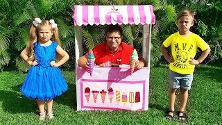 ديانا وروما يتظاهران باللعب مع والدهما في متجر بيع المثلجات