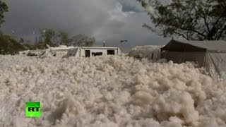 Sea foam fun: Cyclone turns Australian beach into bubble bath