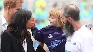 Little boy keeps touching Meghan Markle's hair