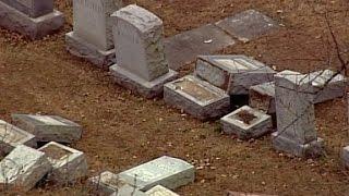 Jewish cemetery vandalized, JCCs receive bomb threats
