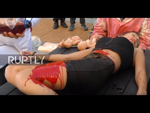 Bulgaria: Vegan activists 'cook and eat' human in gripping street performance