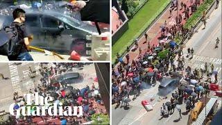 Car rams protesters' barricade in Yuen Long, Hong Kong