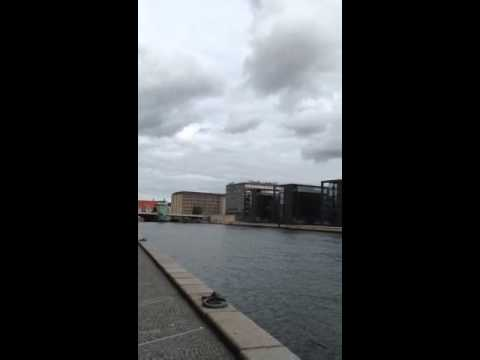 Panorama of Copenhagen waterfront outside The Black Diamond modern building