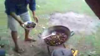 some local people in philippines eating a dog