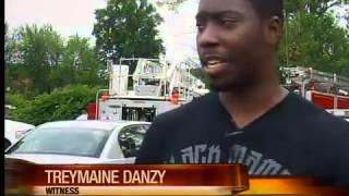 Dump truck in water in Akron