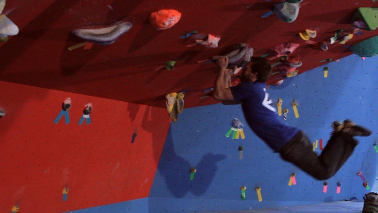 Dyno In Indoor Climbing Rock