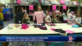 Cradles to Crayons prepares winter gear for children