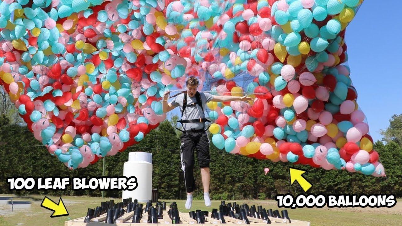 ילד מנסה לעוף בעזרת 10,000 בלונים!! הוא הצליח?!