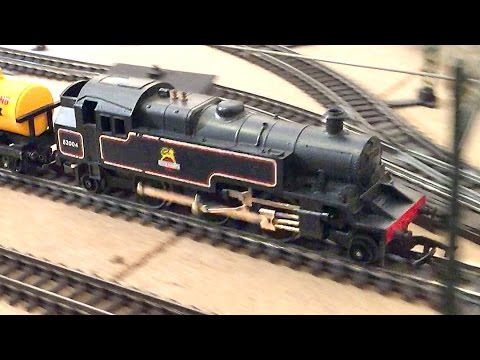 Tri-ang Railways R.59 2-6-2 class 3 Tank Locomotive with mixed fright & Suburban coaches.