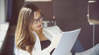 Young Attractive Businesswoman Wearing Glasses Working with Documents | Stock Footage - Videohive