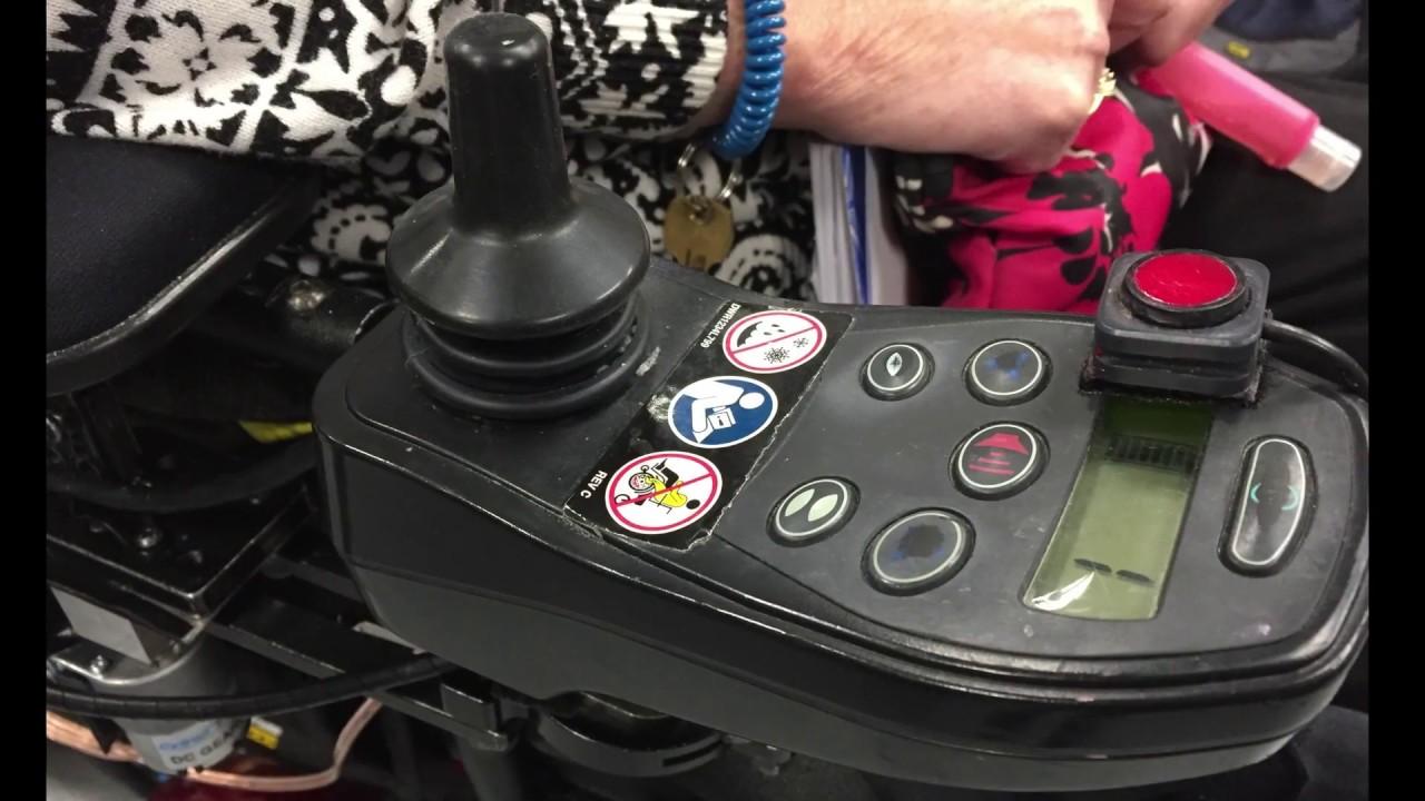 Actuated wheelchair controller mount