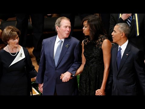 George Bush sways vigorously at Dallas memorial