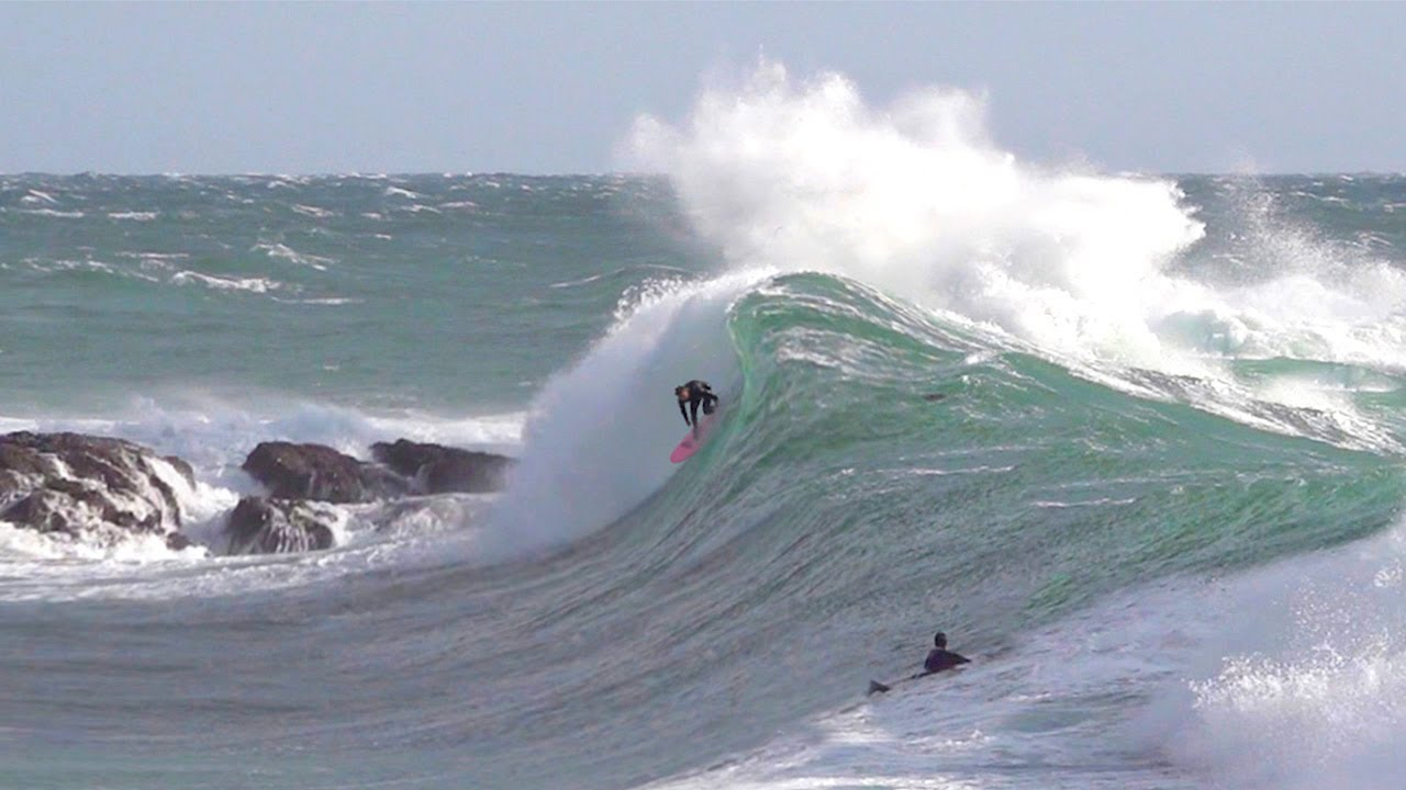 Pro Surfers charge GNARLY storm surf wave !!!