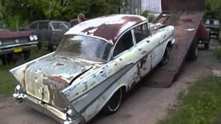 1957 Chevy coming down off truck where it has been for 26 years.