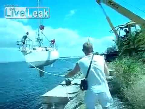 Crane Gently Lowers Boat Into Water