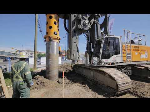 Liebherr 24 and Liebherr 28 installing seacant pile wall using segmental casing