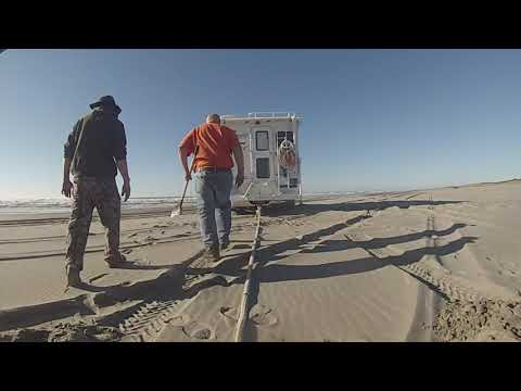 Dodge dually  with camper stuck Surf line