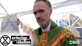"XR Christian Climate Activists in action, ""Faith Belief Conviction"" | Extinction Rebellion"