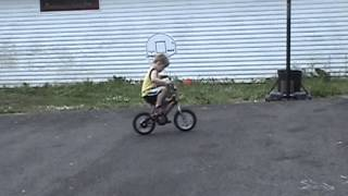 3 year old riding a bike and doing wheelies