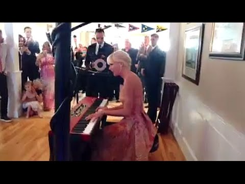 Taylor Swift Surprises Fans With A Performance At Their Wedding