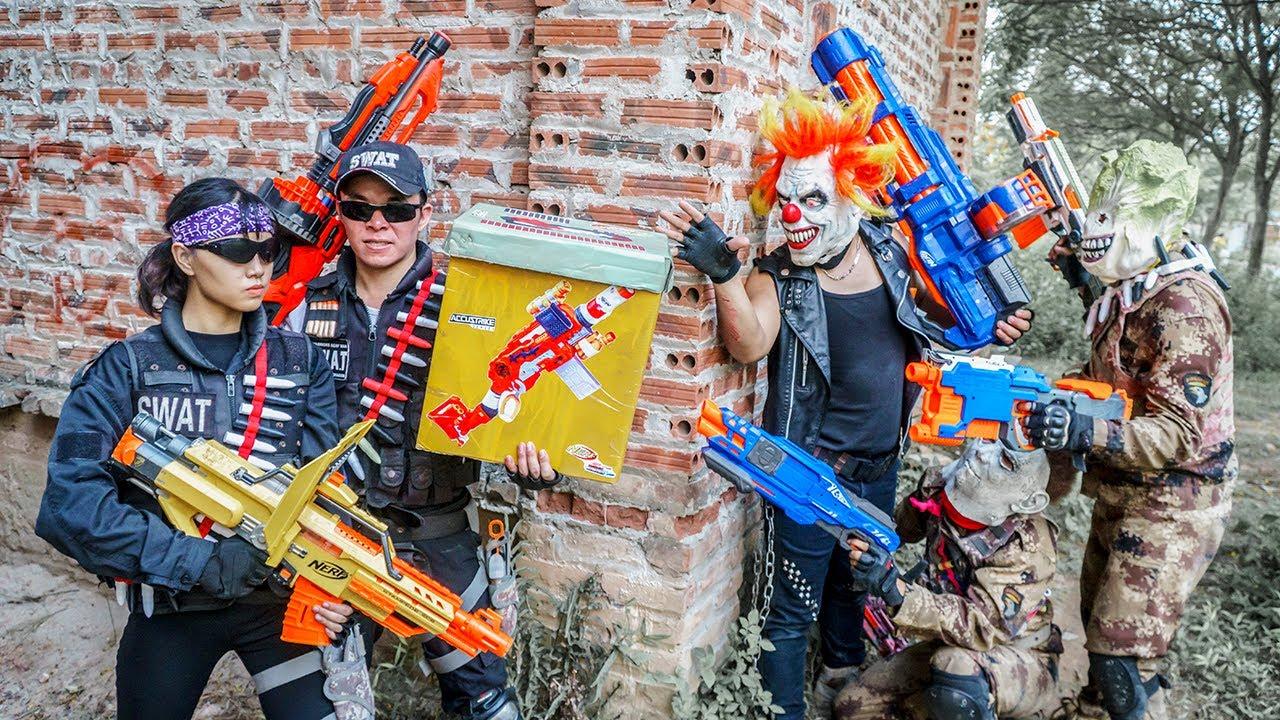 Gugu Nerf War : Couple Cid Dragon Nerf Guns Fight XICMAN Evildoer Bandits Armory