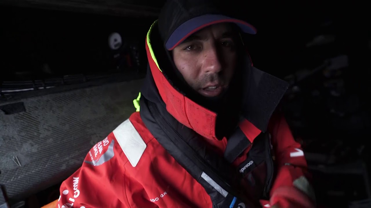 Charlie and Mark get geared up for going on watch. Mark talks about it getting colder, bumpy, and windy. Broad reaching in 25/30 knots. Converging with the other group they had the big split with. Trying to maximize this wind while they have it, before they hit the high-pressure ridge.