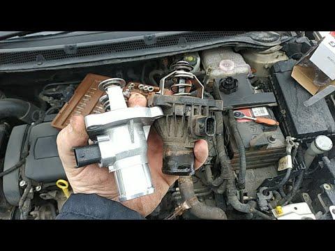 Замена термостата Opel Astra J