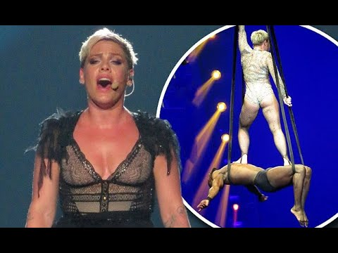 Pink wears unflattering skin-tight leotard as she balances awkwardly on top of an acrobat thumbnail