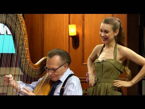 Watch Joanna om Teach Larry King to Play the Harp!  Larry King Now  Ora.TV