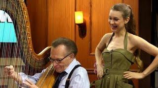watch joanna newsom teach larry king to play the harp   larry king now   ora tv