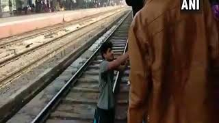 ANI- Baby girl escapes unhurt after a train runs over her at Mathura